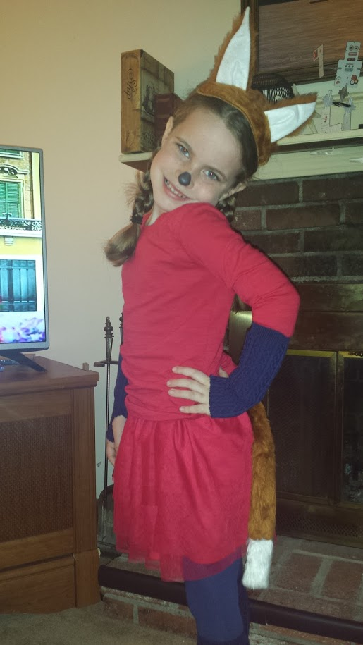 Girl wearing fox in socks costume